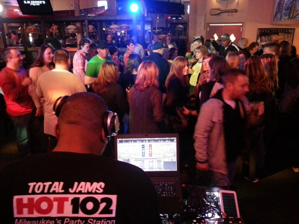 Fresh G busy on the turntables while sporting his HOT102 shirt; the crowd was dancing up a storm.